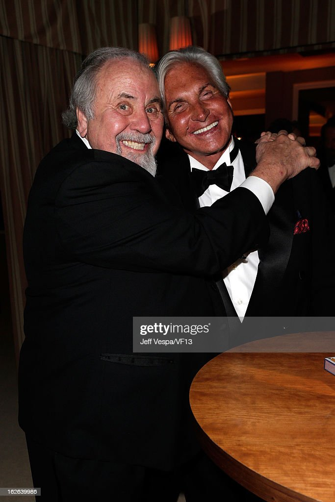 George Slaughter (L) and George Hamilton attend the 2013 Vanity Fair Oscar Party hosted by Graydon Carter at Sunset Tower on February 24, 2013 in West Hollywood, California.
