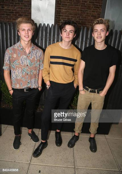 George Smith Blake Richardson and Reece Bibby of the band 'New Hope Club' pose at a fan concert and meet greet at Buffalo Wild Wings Times Square on...
