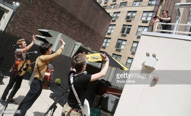 George Smith Blake Richardson and Reece Bibby of the band 'New Hope Club' perform at a fan concert and meet greet at Buffalo Wild Wings Times Square...