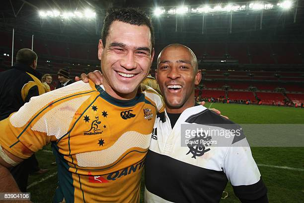 George Smith of Australia and George Gregan of The Barbarians pose together following the final whistle during the 1908 2008 London Olympic Centenary...