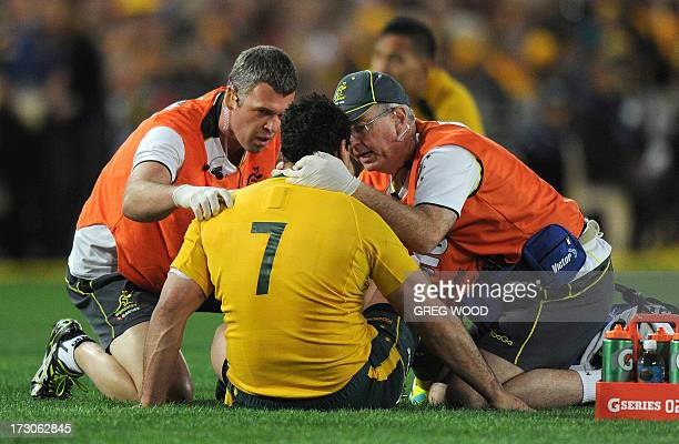 George Smith of Australia is checked by trainers after a heavy clash against the British and Irish Lions during the third and final rugby union Test...