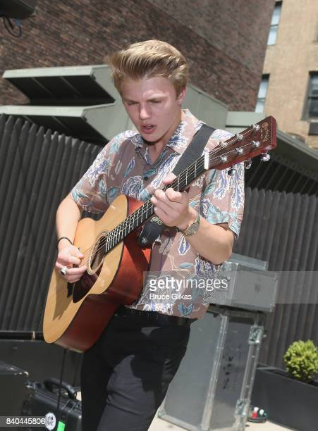 George Smith of the band 'New Hope Club' performs at a fan concert and meet greet at Buffalo Wild Wings Times Square on August 28 2017 in New York...