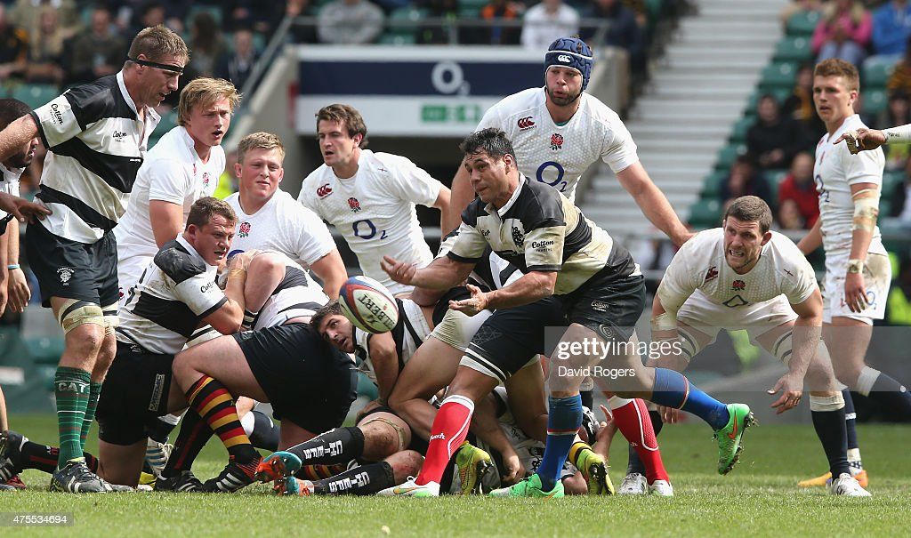 <a gi-track='captionPersonalityLinkClicked' href=/galleries/search?phrase=George+Smith+-+Rugby+Player&family=editorial&specificpeople=15720629 ng-click='$event.stopPropagation()'>George Smith</a> of the Barbarians passes the ball durng the Rugby International match between England and the Barbarians at Twickenham Stadium on May 31, 2015 in London, England.