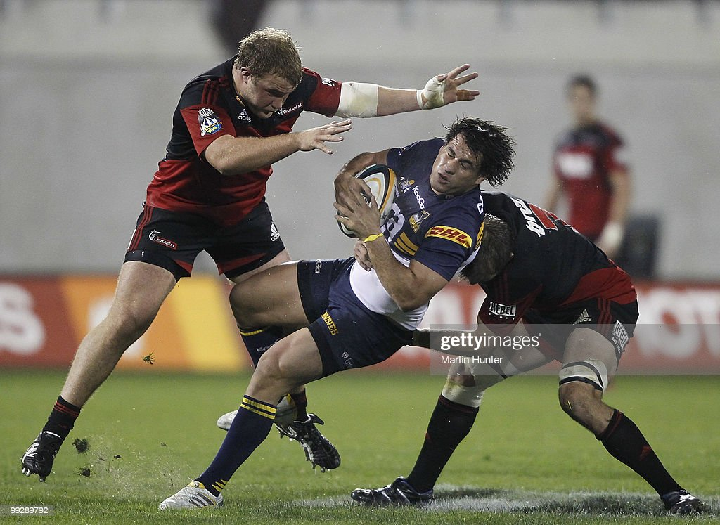 <a gi-track='captionPersonalityLinkClicked' href=/galleries/search?phrase=George+Smith+-+Rugby+Player&family=editorial&specificpeople=15720629 ng-click='$event.stopPropagation()'>George Smith</a> of the Brumbies is tackled by Owen Franks (L) and <a gi-track='captionPersonalityLinkClicked' href=/galleries/search?phrase=Richie+McCaw&family=editorial&specificpeople=165235 ng-click='$event.stopPropagation()'>Richie McCaw</a> of the Crusaders during the round 14 Super 14 match between the Crusaders and the Brumbies at AMI Stadium on May 14, 2010 in Christchurch, New Zealand.