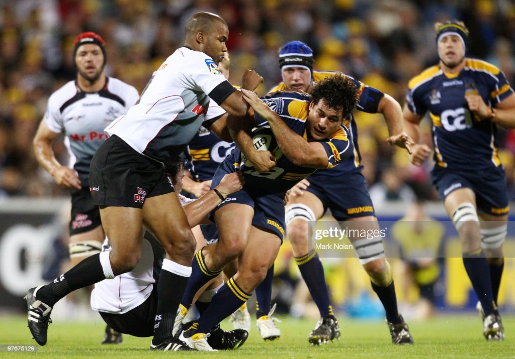 <a gi-track='captionPersonalityLinkClicked' href=/galleries/search?phrase=George+Smith+-+Rugby+Player&family=editorial&specificpeople=15720629 ng-click='$event.stopPropagation()'>George Smith</a> of the Brumbies is tackled during the round five Super 14 match between the Brumbies and the Sharks at Canberra Stadium on March 13, 2010 in Canberra, Australia.