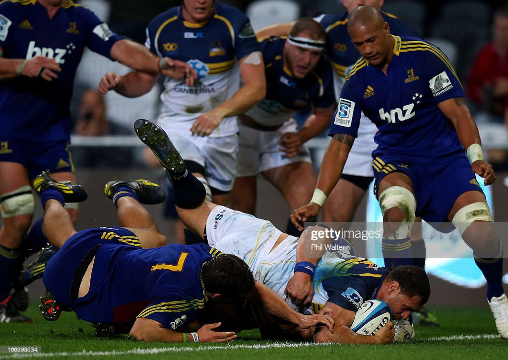 <a gi-track='captionPersonalityLinkClicked' href=/galleries/search?phrase=George+Smith+-+Rugby+Player&family=editorial&specificpeople=15720629 ng-click='$event.stopPropagation()'>George Smith</a> of the Brumbies scores a try during the round nine Super Rugby match between the Highlanders and the Brumbies at the Forsyth Barr Stadium on April 12, 2013 in Dunedin, New Zealand.