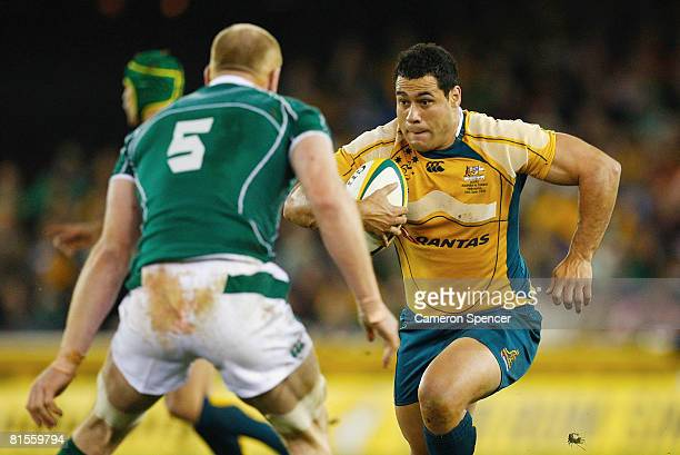 George Smith of the Wallabies runs the ball during the Bundaberg Rum Series Test match between the Australian Wallabies and Ireland at the Telstra...