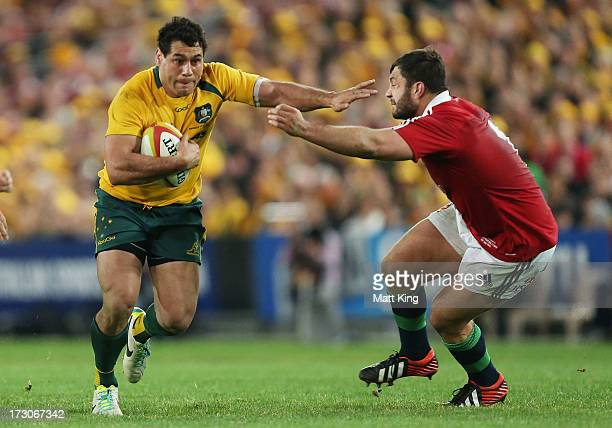 George Smith of the Wallabies takes on the defence during the International Test match between the Australian Wallabies and British Irish Lions at...