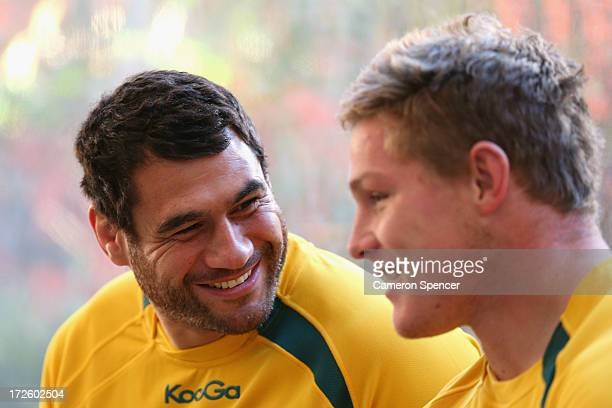 George Smith of the Wallabies talks to team mate Michael Hooper prior to an Australian Wallabies media session at the Shangri la Hotel on July 4 2013...