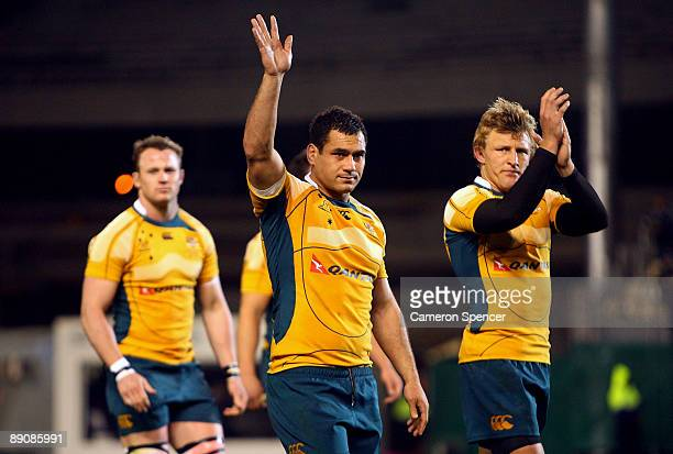 George Smith of the Wallabies waves to fans after losing the 2009 Tri Nations match between the New Zealand All Blacks and the Australian Wallabies...