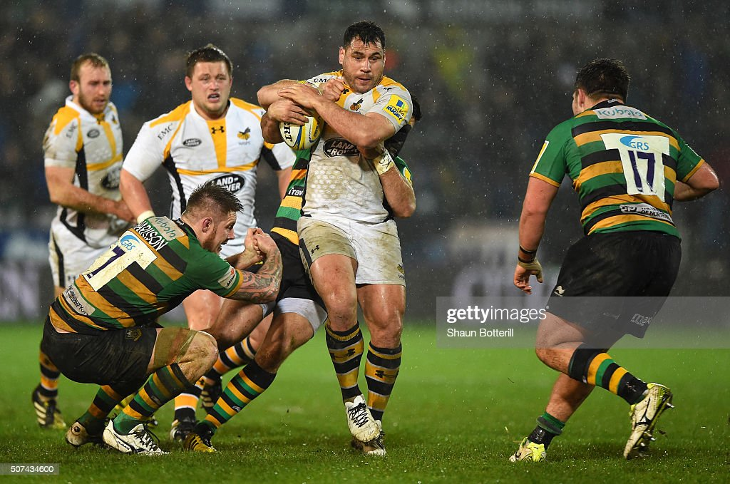 <a gi-track='captionPersonalityLinkClicked' href=/galleries/search?phrase=George+Smith+-+Rugby+Player&family=editorial&specificpeople=15720629 ng-click='$event.stopPropagation()'>George Smith</a> of Wasps is tackled by Gareth Denman of Northampton Saints during the Aviva Premiership match between Northampton Saints and Wasps at Franklin's Gardens on January 29, 2016 in Northampton, England.