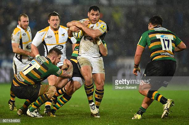 George Smith of Wasps is tackled by Gareth Denman of Northampton Saints during the Aviva Premiership match between Northampton Saints and Wasps at...