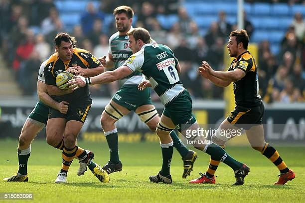 George Smith of Wasps is tackled by Tom Croft of Leicester Tigers during the Aviva Premiership match between Wasps and Leicester Tigers at The Ricoh...
