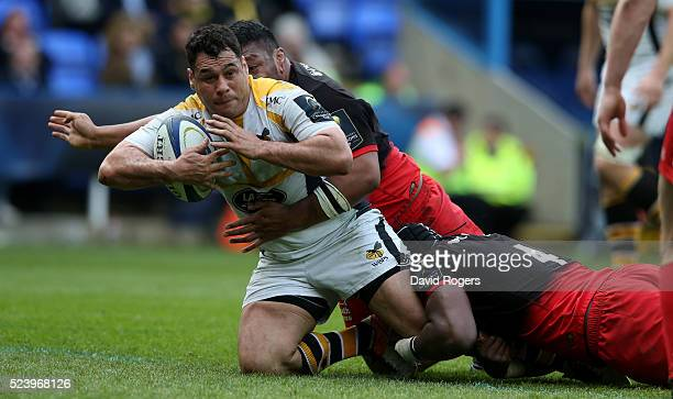 George Smith of Wasps is tackled during the European Rugby Champions Cup semi final match between Saracens and Wasps at Madejski Stadium on April 23...