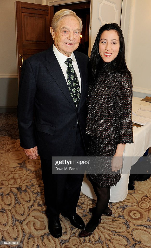<a gi-track='captionPersonalityLinkClicked' href=/galleries/search?phrase=George+Soros&family=editorial&specificpeople=212841 ng-click='$event.stopPropagation()'>George Soros</a> (L) and Tamika Bolton attend a cocktail reception at the 4th Fortune Forum Summit held at The Dorchester on December 4, 2012 in London, England.