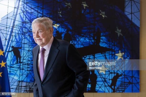 George Soros billionaire and founder of Soros Fund Management LLC poses for a photograph ahead of a meeting with the President of the European...
