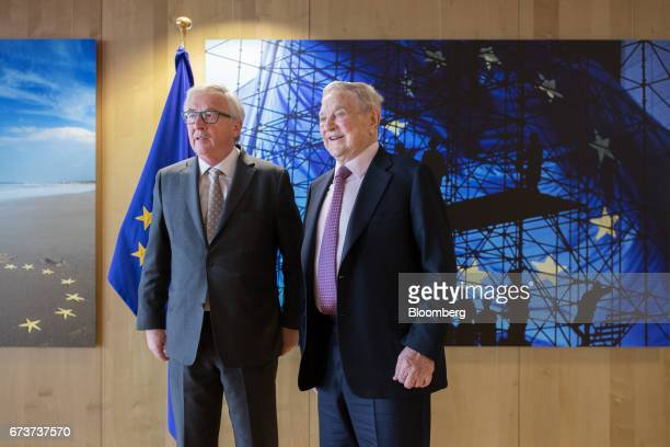 George Soros billionaire and founder of Soros Fund Management LLC right and JeanClaude Juncker president of the European Commission pose for a...