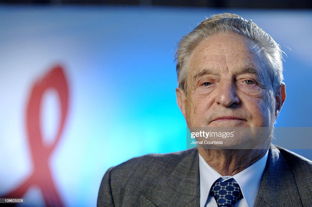 <a gi-track='captionPersonalityLinkClicked' href=/galleries/search?phrase=George+Soros&family=editorial&specificpeople=212841 ng-click='$event.stopPropagation()'>George Soros</a>, CEO and Chairman of the Soros Foundations Network, speaks with Grant Clark of BET News about the contributions of his organization to the global fight against the AIDS pandemic, at the New York offices of the Soros Foundations Network on October 4, 2006 in New York City.