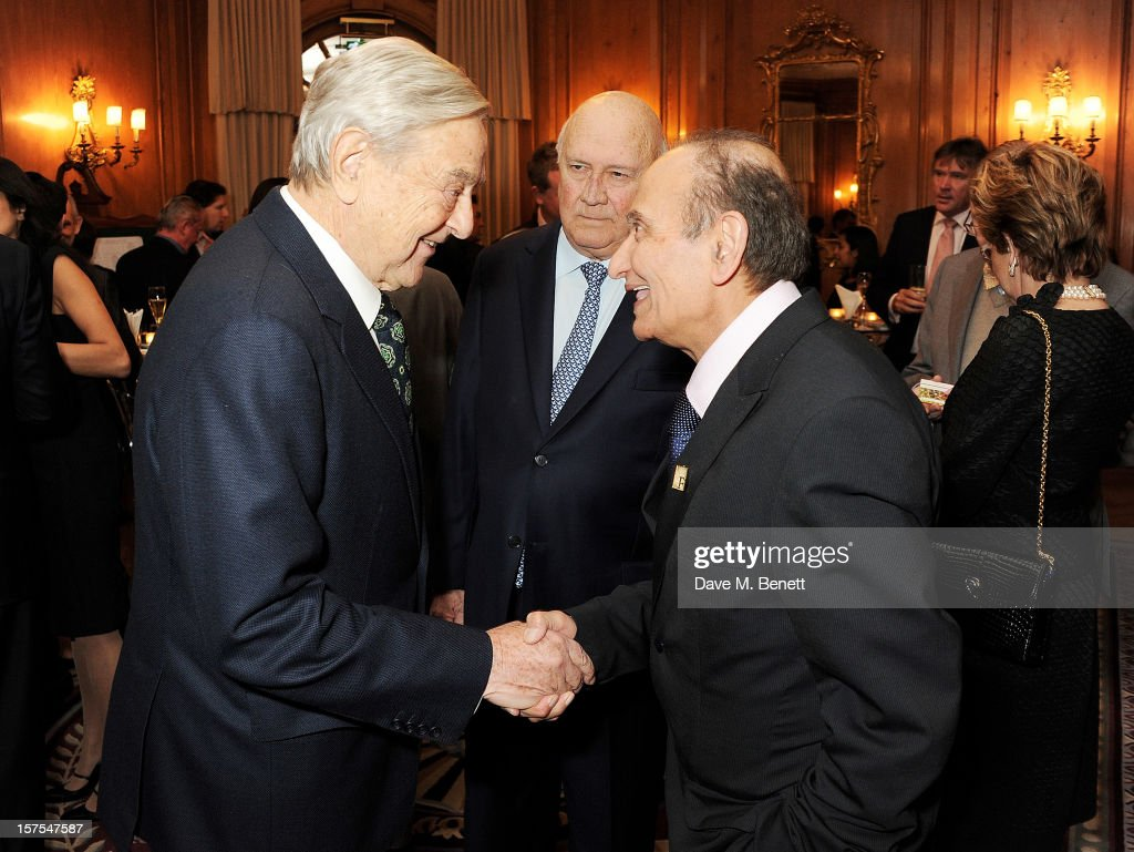 <a gi-track='captionPersonalityLinkClicked' href=/galleries/search?phrase=George+Soros&family=editorial&specificpeople=212841 ng-click='$event.stopPropagation()'>George Soros</a>, Former South African President <a gi-track='captionPersonalityLinkClicked' href=/galleries/search?phrase=F.W.+de+Klerk&family=editorial&specificpeople=228077 ng-click='$event.stopPropagation()'>F.W. de Klerk</a> and Vijay Mehta attend a cocktail reception at the 4th Fortune Forum Summit held at The Dorchester on December 4, 2012 in London, England.