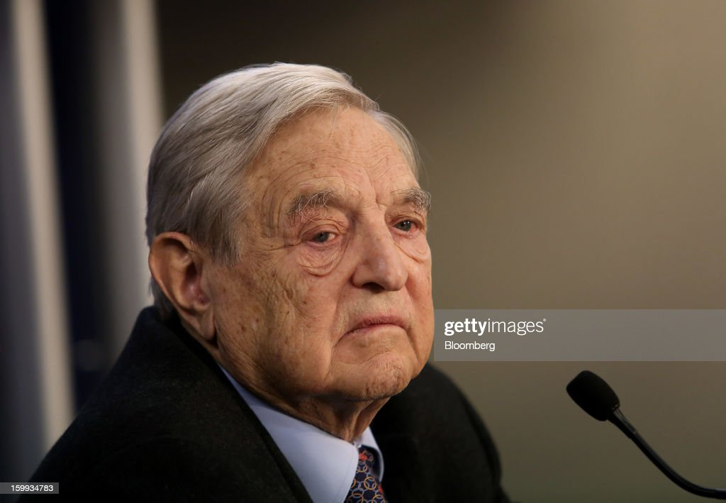 <a gi-track='captionPersonalityLinkClicked' href=/galleries/search?phrase=George+Soros&family=editorial&specificpeople=212841 ng-click='$event.stopPropagation()'>George Soros</a>, founder of Soros Fund Management LLC, pauses while speaking during a forum session on the opening day in Davos, Switzerland, on Wednesday, Jan. 23, 2013. World leaders, Influential executives, bankers and policy makers attend the 43rd annual meeting of the World Economic Forum in Davos, the five day event runs from Jan. 23-27. Photographer: Chris Ratcliffe/Bloomberg via Getty Images