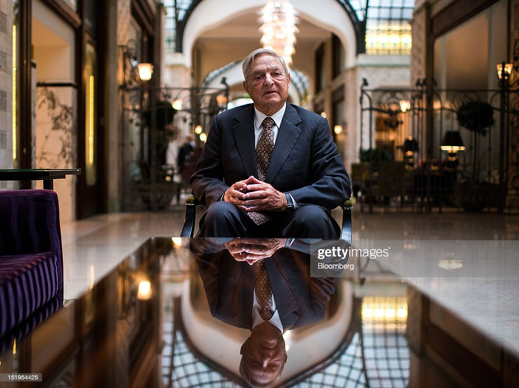 <a gi-track='captionPersonalityLinkClicked' href=/galleries/search?phrase=George+Soros&family=editorial&specificpeople=212841 ng-click='$event.stopPropagation()'>George Soros</a>, founder of Soros Fund Management LLC, poses for a photograph following a Bloomberg Television interview in Budapest, Hungary, on Thursday, Sept. 13, 2012. Soros said he expects Spain to request a 'very limited' bailout from the European Union, with Prime Minister Mariano Rajoy seeking to avoid damaging political fallout at home. Photographer: Akos Stiller/Bloomberg via Getty Images