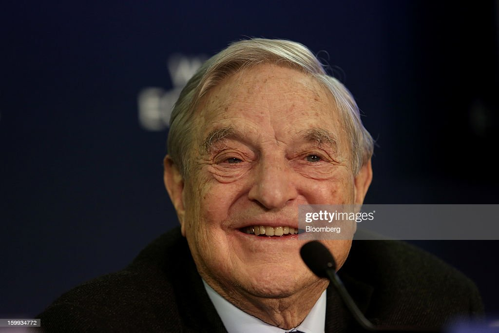 George Soros, founder of Soros Fund Management LLC, smiles during a forum session on the opening day in Davos, Switzerland, on Wednesday, Jan. 23, 2013. World leaders, Influential executives, bankers and policy makers attend the 43rd annual meeting of the World Economic Forum in Davos, the five day event runs from Jan. 23-27. Photographer: Chris Ratcliffe/Bloomberg via Getty Images