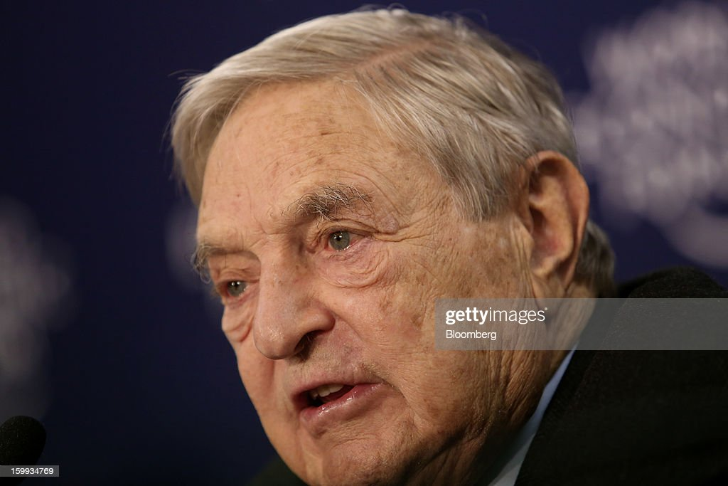 <a gi-track='captionPersonalityLinkClicked' href=/galleries/search?phrase=George+Soros&family=editorial&specificpeople=212841 ng-click='$event.stopPropagation()'>George Soros</a>, founder of Soros Fund Management LLC, speaks during a forum session on the opening day in Davos, Switzerland, on Wednesday, Jan. 23, 2013. World leaders, Influential executives, bankers and policy makers attend the 43rd annual meeting of the World Economic Forum in Davos, the five day event runs from Jan. 23-27. Photographer: Chris Ratcliffe/Bloomberg via Getty Images
