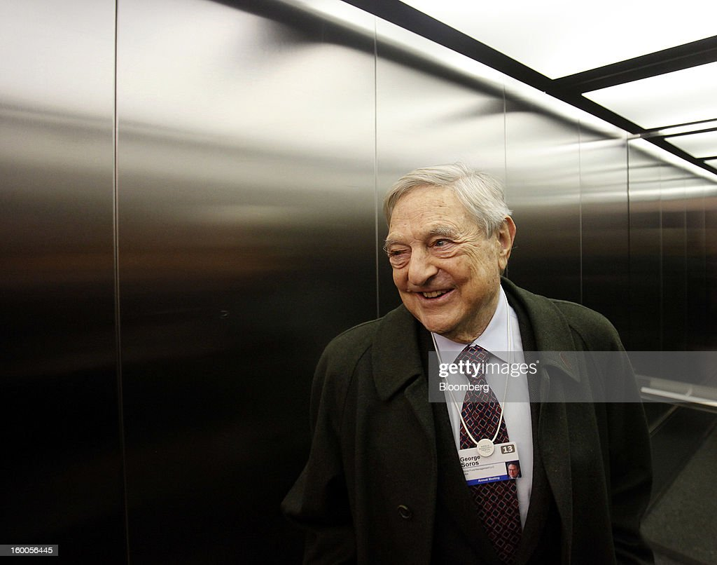 George Soros, founder of Soros Fund Management LLC, takes the lift inside the Congress Center on day three of the World Economic Forum (WEF) in Davos, Switzerland, on Friday, Jan. 25, 2013. World leaders, influential executives, bankers and policy makers attend the 43rd annual meeting of the World Economic Forum in Davos, the five day event runs from Jan. 23-27. Photographer: Simon Dawson/Bloomberg via Getty Images