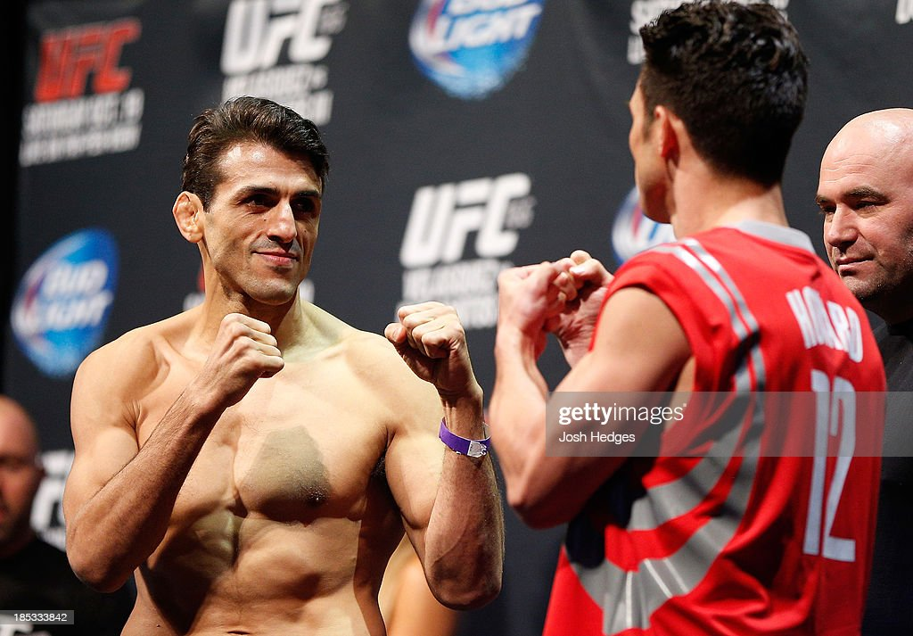 George Sotiropoulos faces off with opponent Karl 'K.J.' Noons during the UFC 166 weigh-in event at the Toyota Center on October 18, 2013 in Houston, Texas.