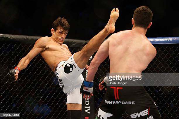 George Sotiropoulos kicks at KJ Noons in their UFC lightweight bout at the Toyota Center on October 19 2013 in Houston Texas