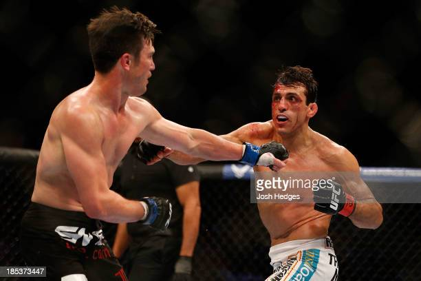 George Sotiropoulos looks to strike KJ Noons in their UFC lightweight bout at the Toyota Center on October 19 2013 in Houston Texas