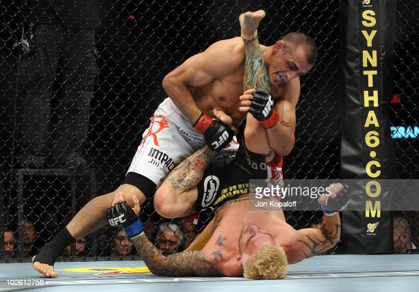 George Sotiropoulos of Australia holds down Kurt Pellegrino during the UFC lightweight bout at the MGM Grand Garden Arena on July 3 2010 in Las Vegas...