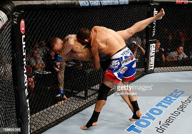 George Sotiropoulos takes down Ross Pearson during their lightweight fight at the UFC on FX event on December 15 2012 at Gold Coast Convention and...