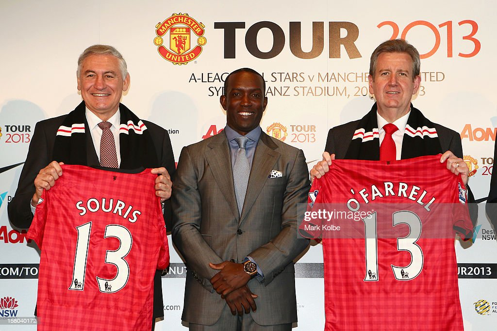 George Souris MP, <a gi-track='captionPersonalityLinkClicked' href=/galleries/search?phrase=Dwight+Yorke+-+Soccer+Player&family=editorial&specificpeople=206855 ng-click='$event.stopPropagation()'>Dwight Yorke</a> and NSW Premier Barry O'Farrell pose after a press conference at Museum of Contemporary Art on December 10, 2012 in Sydney, Australia. Manchester United will play an A-League All-Stars match in Sydney on July 20, 2013.