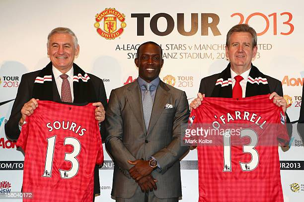 George Souris MP Dwight Yorke and NSW Premier Barry O'Farrell pose after a press conference at Museum of Contemporary Art on December 10 2012 in...