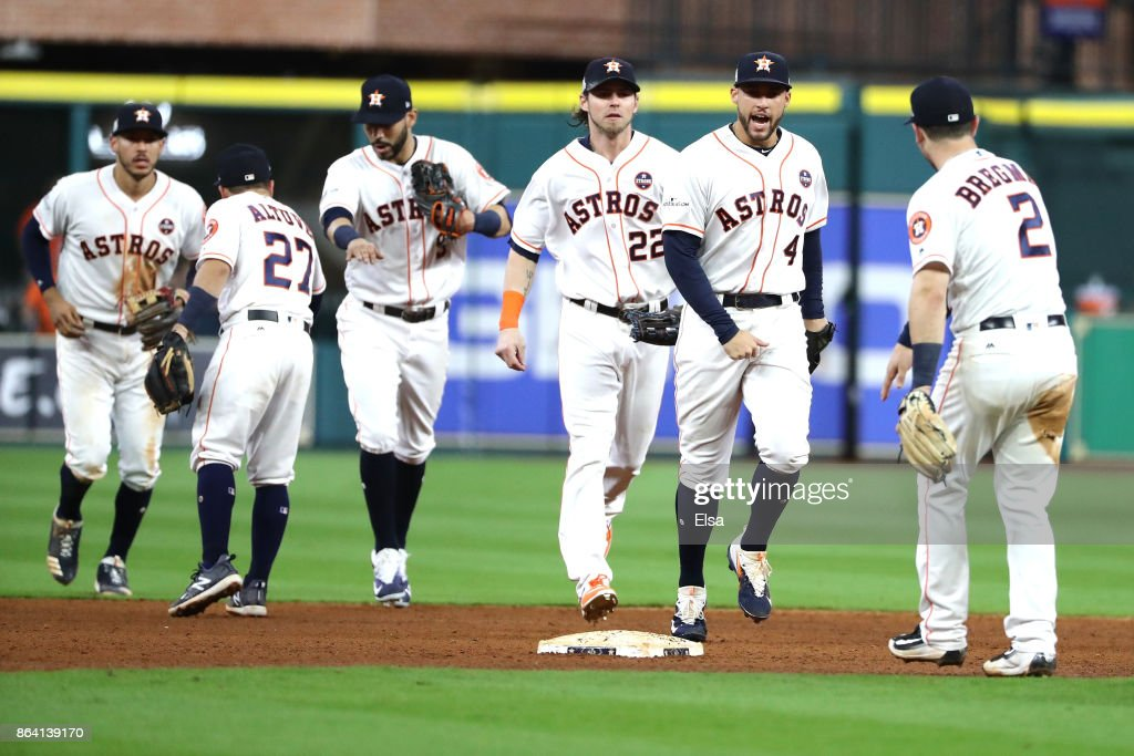 George Springer #4 and Alex Bregman #2 of the Houston Astros celebrates with their teammates after defeating the New York Yankees with a score of 7 to 2 in Game Six of the American League Championship Series at Minute Maid Park on October 20, 2017 in Houston, Texas.