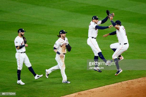 George Springer and Carlos Correa of the Houston Astros celebrate after defeating the Los Angeles Dodgers in game three of the 2017 World Series at...