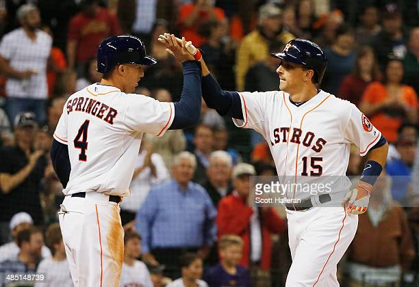 George Springer and Jason Castro of the Houston Astros celebrate after Castro hit a tworun home run in the fourth inning during their game against...
