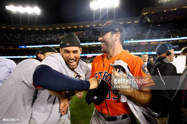 George Springer and Justin Verlander of the Houston Astros celebrate after defeating the Los Angeles Dodgers 51 in game seven to win the 2017 World...