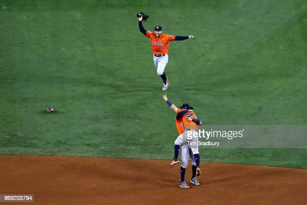 George Springer Carlos Correa and Jose Altuve of the Houston Astros celebrate defeating the Los Angeles Dodgers 51 in game seven to win the 2017...