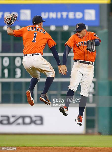 George Springer of the Houston Astros and Carlos Correa celebrate afte the 50 win over the Chicago White Sox at Minute Maid Park on July 1 2016 in...