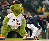 George Springer of the Houston Astros and mascot Orbit await a ceremonial first pitch at Minute Maid Park on August 26 2014 in Houston Texas