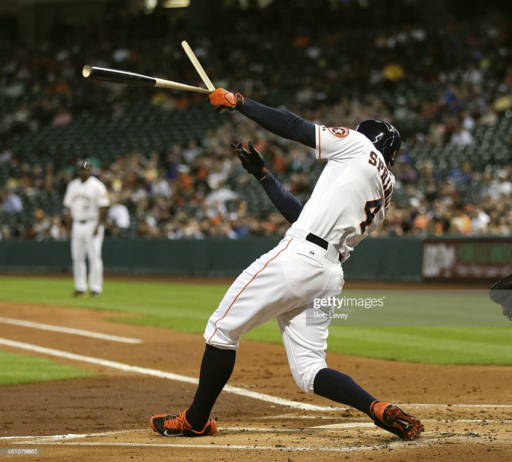 <a gi-track='captionPersonalityLinkClicked' href=/galleries/search?phrase=George+Springer&family=editorial&specificpeople=8060257 ng-click='$event.stopPropagation()'>George Springer</a> #4 of the Houston Astros breaks his bat in the first inning against the Seattle Mariners at Minute Maid Park on July 1, 2014 in Houston, Texas.