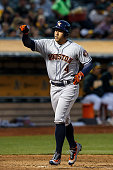 George Springer of the Houston Astros celebrates after hitting a home run against the Oakland Athletics during the fifth inning at the Oakland...