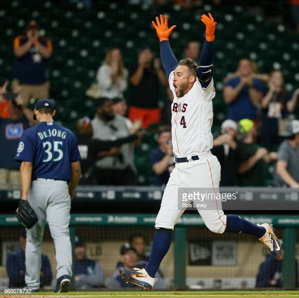 George Springer of the Houston Astros celebrates after hitting a three run home run in the thirteenth inning to give them a 53 win at Minute Maid...