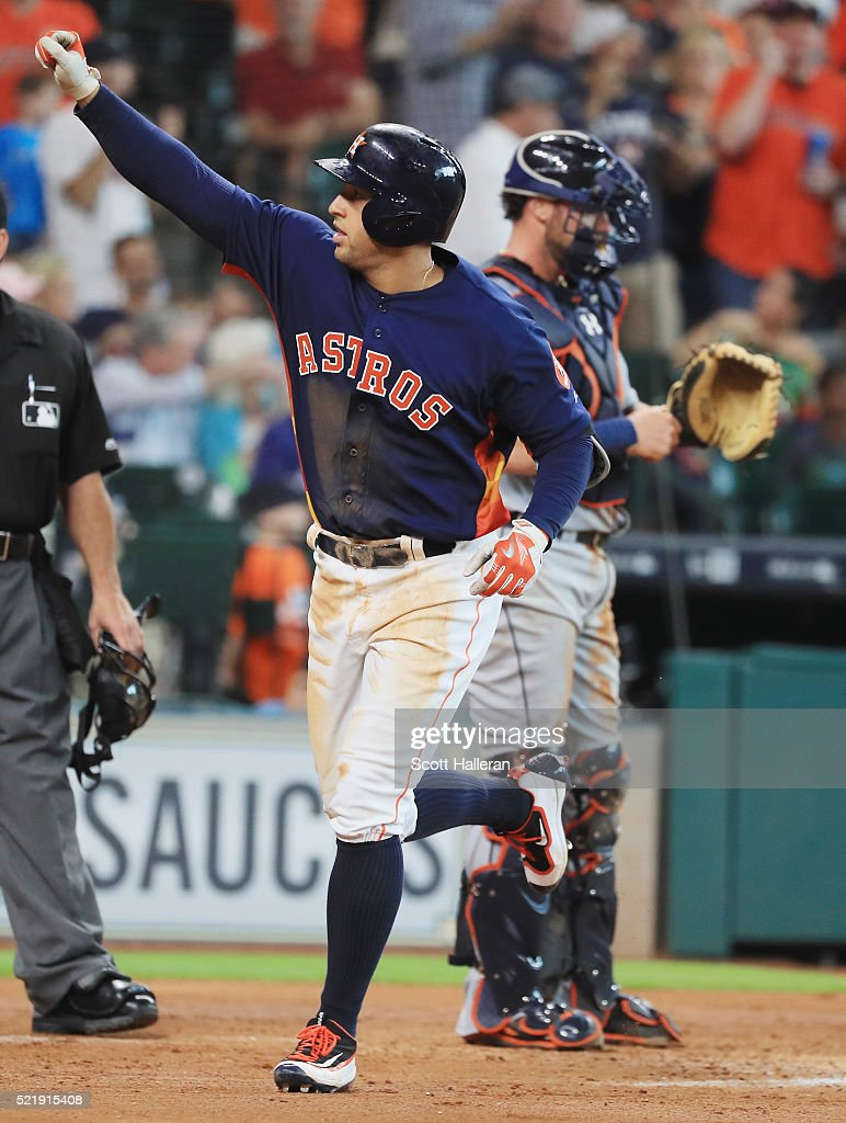 George Springer #4 of the Houston Astros celebrates after hitting a solo home run during the third inning of their game against the Detroit Tigers at Minute Maid Park on April 17, 2016 in Houston, Texas.