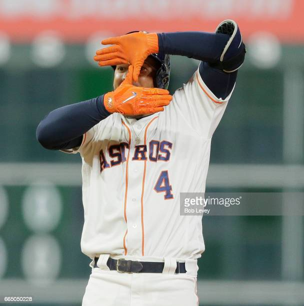 George Springer of the Houston Astros celebrates aftere hitting a tworun double in the seventh inning against the Seattle Mariners at Minute Maid...
