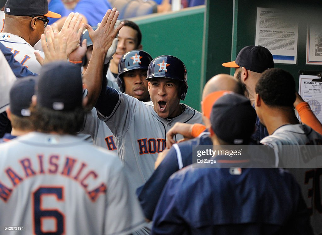 George Springer #4 of the Houston Astros celebrates his grand slam with teammates in the first inning against the Kansas City Royals at Kauffman Stadium on June 24, 2016 in Kansas City, Missouri.