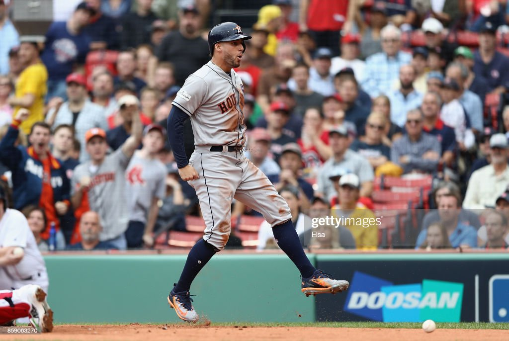 George Springer #4 of the Houston Astros celebrates scoring a run in the first inning against the Boston Red Sox during game three of the American League Division Series at Fenway Park on October 8, 2017 in Boston, Massachusetts.