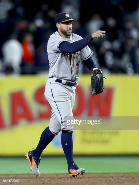 George Springer of the Houston Astros celebrates the 51 win over the New York Yankees on May 12 2017 at Yankee Stadium in the Bronx borough of New...